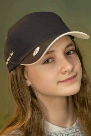 Girl in black cap